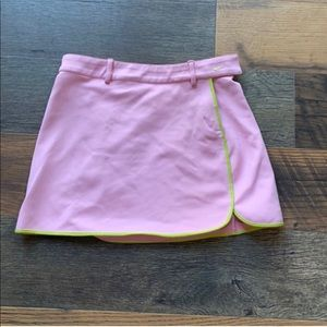 Pink mini Nike tennis skirt with green lining.